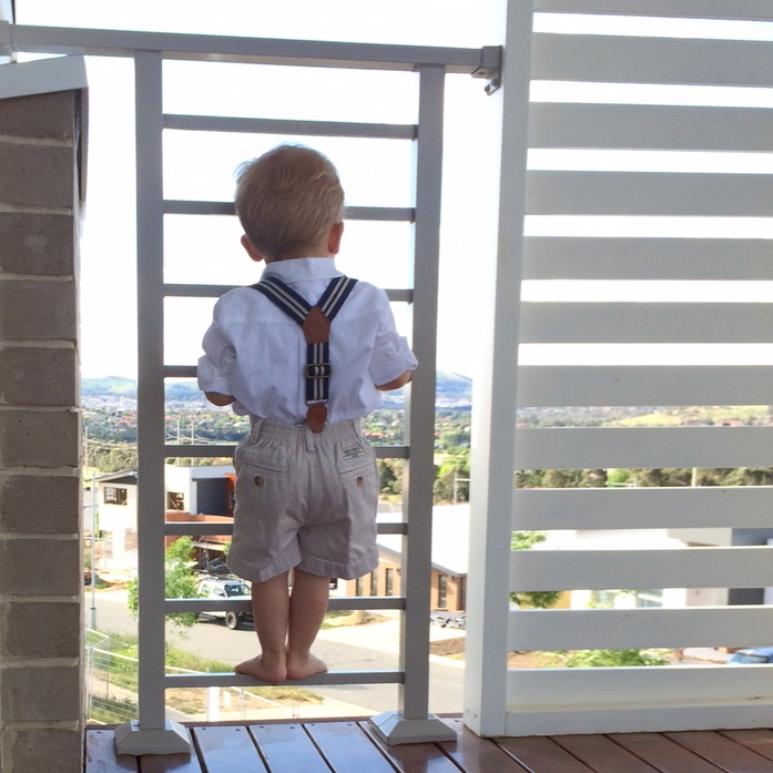 You see a baby on a balcony. I see a tiny coffin.