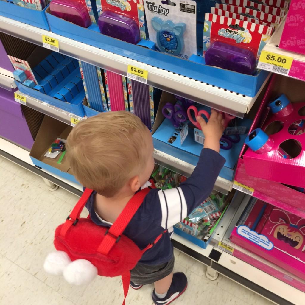 toddler wearing elmo harness