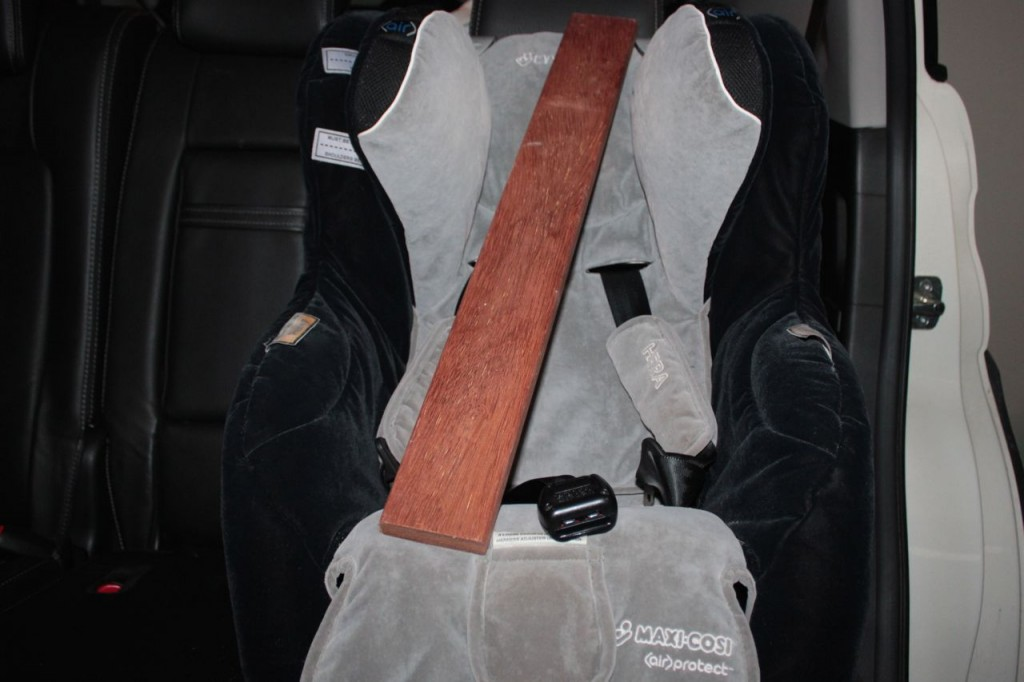 baby car seat with plank of wood