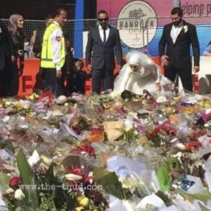A Muslim bride lays her bridal bouquet at the flower memorial at Martin Place in Sydney. Site of the Lindt Cafe siege.
