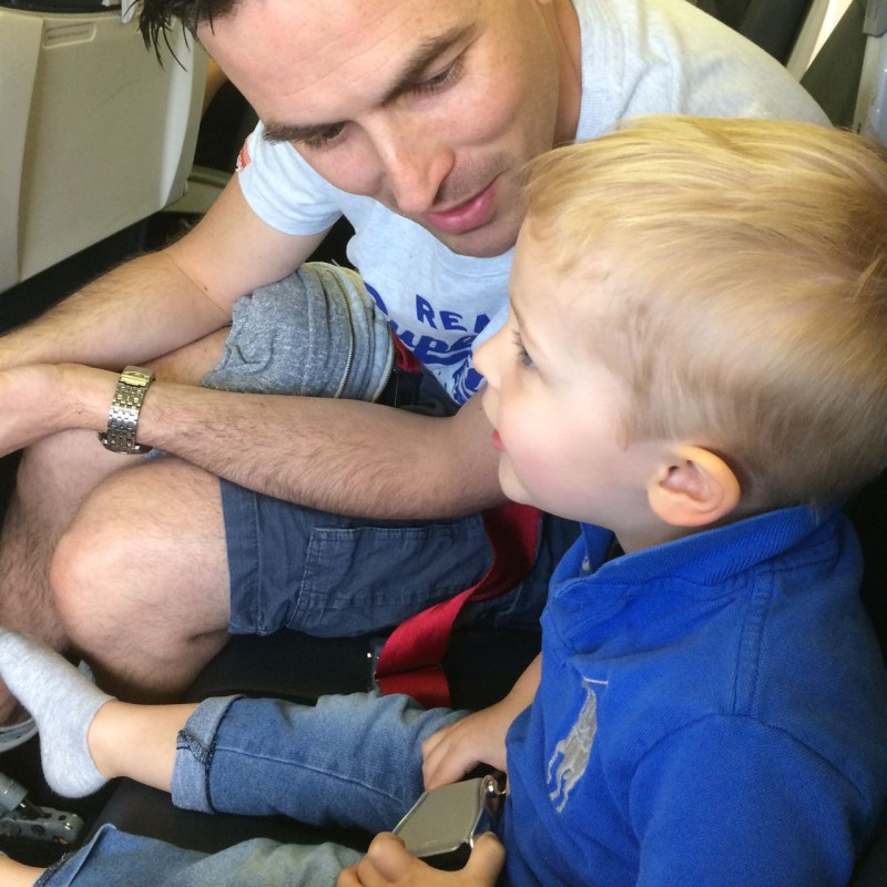 Travelling with toddlers - moment of quiet negotiation with daddy on the airplane