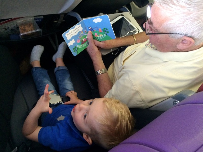Travelling with toddlers - Sitting with Grandpa on the airplane