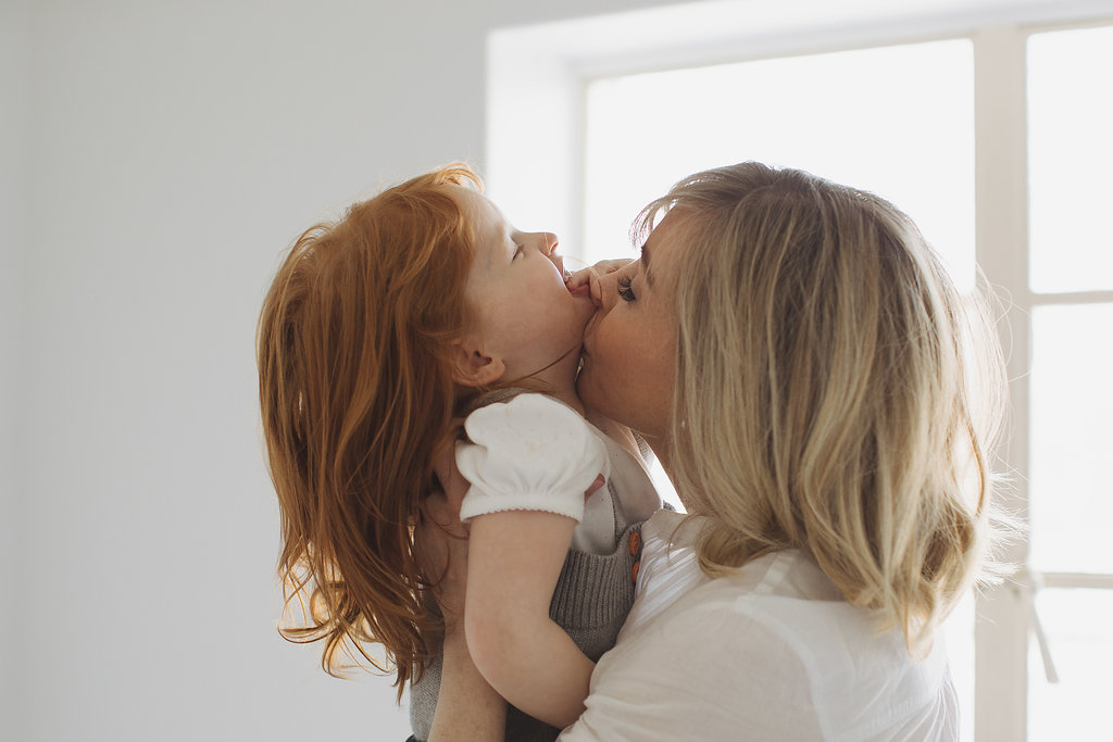 daughter kisses